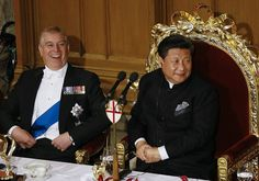 Duke of York, Prince Andrew laughs as he sits beside President Xi at the banquet, held in honour of the state visit, this evening
