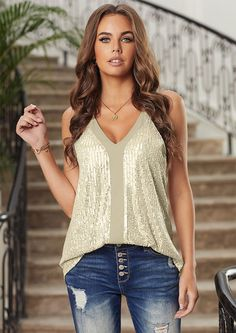 Trending now: This irresistible sparkly tank top adopts sequin layer with spaghetti straps and panel font. With it soft lining it make it comfortable to wear. It creates beautiful sparkle in the stage lights on the dance floor. Wear it with your skinny jeans and high heel and you are ready to sparkle the night away. Sequin Cami Top, Stage Lighting, Trending Now, Cami Tops, Spaghetti Straps, High Heel, How To Make, How To Wear
