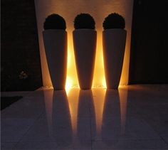 up and down lights behind the pots create an amazing glow contemporary garden design manchester amazing garden lighting flower