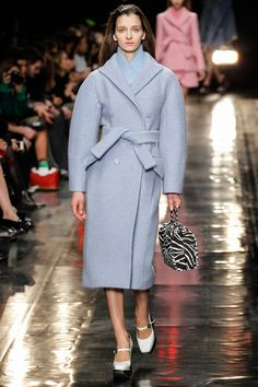 #CARVEN #FW13 #PFW Rounded shoulders with a notch collar coat. Sky blue felted wool  is used to make the coat thick and structured.