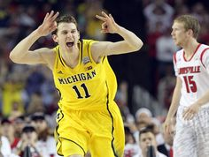 Curtis Compton Michigan guard Nik Stauskas reacts to hitting a shot against Louisville during the first half.