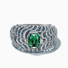 The AGTA Daily Gem: Incredible platinum bracelet featuring a 45.44 ct. green Tourmaline accented with Sapphires, tsavorite Garnets and Diamonds from AGTA Member, Tiffany & Co.