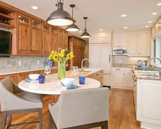 Two-Tone Warm and Welcoming Galley Kitchen in Minneapolis MN