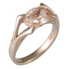 Carved Branch Unique Engagement Ring in Rose Gold - Two sets of branches unite in the center of this unique engagement ring, representing unity and growth. 3mm wide. - This unique ring has an oval 2.17 carat natural untreated pinkish orange sapphire. 18k rose gold. Size 7. 0.03 ctw white accent diamonds.