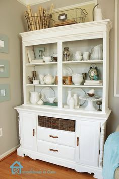 Hutch makeover - A dark free Craiglist find is transformed with paint and moldings - Basket drawer & leather pulls