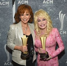 Dolly Parton & Reba McEntire with their trophies at the Academy of Country Music Awards.