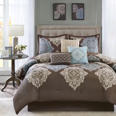 Update your space with the Madison Park Barnett comforter set. The rich, chocolate-brown cotton sateen fabric features an aqua and khaki damask design across the center of the comforter, coordinating with the shams and accent pillows.