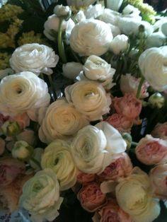 ranunculous and blush spray garden roses