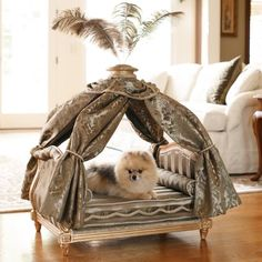 Drawing inspiration from French antique furniture, our Marie Antoinette Pet Bed is designed to surround your pet with regal splendor evocative of European aristocracy. Opulent, plush, and richly embellished, this bed will make any pet feel like royalty. 4-poster bed boasts braid-trimmed upholstered headboard Lined chenille curtains are tied with silken cords Gold-leaf frame is crafted from d...