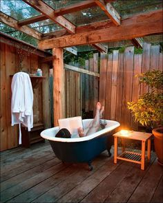 I need an outdoor bathtub for two in my life...we can read together w/glasses of wine #myhappyplace