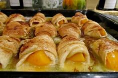 Peach Dumplings 2 whole large peaches 2 8 oz cans crescent rolls 2 sticks butter 1-1/2 cup sugar 1 tsp vanilla cinnamon, to taste 1 12 oz can Mountain Dew Peel/pit peaches. Cut both into 8 slices. Roll each slice in a crescent roll. Place in a 9 x 13 buttered pan. Melt butter, add sugar and barely stir. Add vanilla, stir, and pour entire mixture over peaches. Pour Mountain Dew around the edges of the pan. Sprinkle with cinnamon and bake at 350 degrees for 40 minutes. Serve with ice cream.
