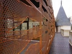 Chateau de Cange - perforated metal facades