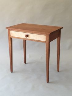 Simple side table design shown in cherry with a curly maple drawer-front. Fine handmade wooden furniture by Joseph van Benten Furnituremakers in Brookline, Massachusetts. Maple Furniture, Furniture Design Modern, Modern Farmhouse Furniture, Wood End Tables, Shaker Furniture, Coffee Table Design, Hardwood Table, Woodworking Furniture, Custom Furniture