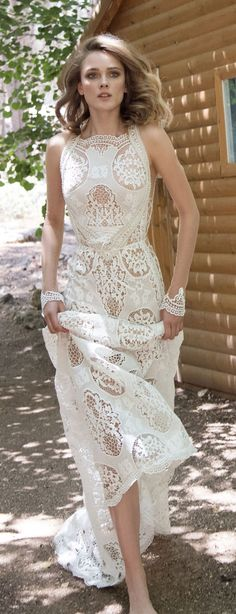GALA 905. Boho styled a-line flare dress with geometric cut outs and embroideries throughout the gown. Cutouts on the sides with lace tied up and sheer long sleeves with appliques on the wrists.