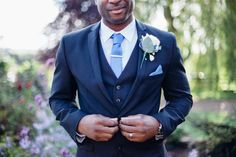 Groom wedding navy blue 3 piece suit for with pastel blue tie