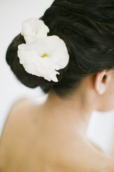 White bloom up-do | Read More: http://www.stylemepretty.com/2014/07/15/modern-black-tie-gatsby-inspired-wedding-at-501-union/ | Photography: CLY By Chung - www.clybychung.com/