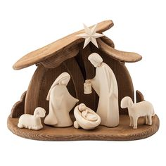 5 nativity figures (Mary and Joseph, the Christ child in the cradle and a reclining and a standing lamb) and one star made of maple. The stable (length 36 cm, width cm, height. - Nativity Scene Hand Carved from Maple and Walnut Wood at Manufactum Christmas Clay, Christmas Nativity Scene, Christmas Crafts, Christmas Decorations, Nativity Scenes, Christmas Bells, Christmas Printables, Christmas Angels, Clay Crafts