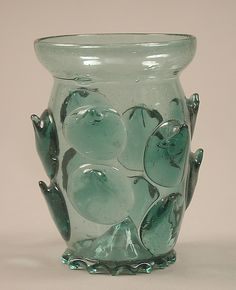 Beaker 15th Century - Beaker    Date:      15th century  Culture:      German  Medium:      Glass  Dimensions:      Overall: 4 1/8 x 3 1/16 in. (10.5 x 7.8 cm) Base: 2 1/16 in. (5.3 cm)  Classification:      Glass-Vessel  Credit Line:      Munsey Fund, 1927  Accession Number:      27.185.207