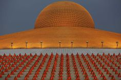 Buddhist monks pray at the Wat Phra Dhammakaya temple in Pathum Thani province, north of Bangkok