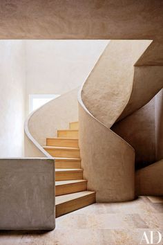 In landscape designer Fernando Carucho's airy studio in Madrid, a staircase is crafted of lime mortar and Russian white pine   archdigest.com