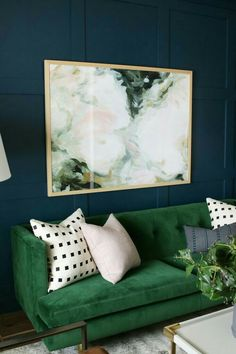 Obsessed with emerald green couches & chairs these days.