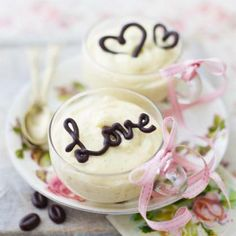 Cream pots with love written in chocolate