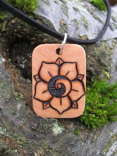 "Yin Yang Lotus Sea Star Pyrography 1 3/8"" Wood Pendant Double-sided. $18.00, via Etsy."