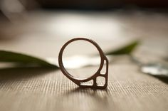 laser cut wooden ring by RUNECYCLE Wooden Rings, Geometric Jewelry, Laser Cutting, Silver Rings, Wedding Rings, Engagement Rings, 3d, Wood Rings, Wedding Ring