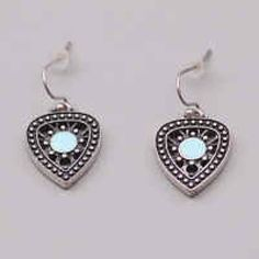 Lucky Brand Blue Pick Earrings These are Lucky Brand pick shaped earrings with blue centers Lucky Brand Jewelry Earrings