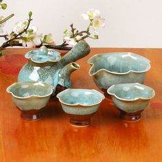 Korean tea set - I'm a sucker for wavy cups.  Probably a good thing the link doesn't work.  Pretty to look at just the same.