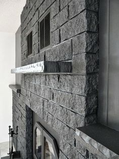 Most current Images Stone Fireplace update Ideas How to Easily Paint a Stone Fireplace (Charcoal Grey Fireplace Makeover) Faux Stone Fireplaces, Painted Stone Fireplace, Stone Fireplace Makeover, Painted Brick Walls, Slate Fireplace, Paint Fireplace, Fireplace Ideas, Fireplace Update, Fireplace Makeovers