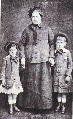 """Illiers-Combray: """"Virginia Proust and her two grandchildren, Marcel right and Robert left (maybe late 1876). Both children wear hats and skirt as was the custom then imposing these clothes for boys until their sixth birthday."""" From: (http://proustien.over-blog.com/pages/Quelques_heures_a_IlliersCombray-4387535.html)"""