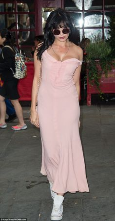 Looking good: She drew attention to her cleavage thanks to the sweetheart neckline and sub...