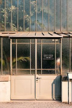 the better to (un)see you with. / sfgirlbybay greenhouse exterior with glass walls and doors. Facade Design, Door Design, House Design, Cafe Interior, Interior And Exterior, Interior Design, Brewery Interior, Shop Facade, Restaurant Design