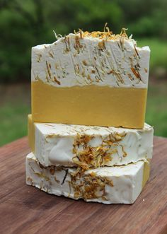 Our Sunshine Goat Milk Soap is scented with a lovely mix of Orange Essential and Yuzu. It's a wonderful citrusy scent. Marigold petals (Calendula) are added to add interest and a bit of exfoliation. C