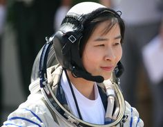 Liu Yang, China's first woman in space, boarded a spacecraft in western China on Saturday.