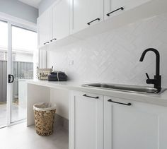 SPLASHBACK A white textured overlay to bring the hamptons to life in the laundry. Also admire the matte black tapware and handles for a a bold yet beautiful contrast. Laundry Room Tile, Laundry Nook, Room Tiles, Small Laundry, Kitchen Tiles, Kitchen Splashback Ideas, Laundry Cabinets, Modern Laundry Rooms, Laundry Baskets