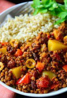 cuban rice This vegan picadillo recipe is a delicious and colourful Cuban-style dish of spiced lentils, potatoes, tomatoes, olives and raisins. Served with rice, its quick and easy to prepare for a weeknight dinner. Vegan Foods, Vegan Dishes, Vegan Vegetarian, Vegetarian Recipes, Healthy Recipes, Vegan Lentil Recipes, Vegan Raw, Veggie Recipes, Whole Food Recipes