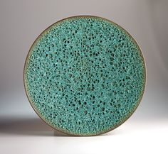 James Lovera (American, born 1920)    MOLTEN BLUE-GREEN CRATER BOWL, 2005    Porcelain with copper oxide crater glaze over black vitreous slip  4 1/2 in. x 17 1/4 in. (11.43 cm x 43.82 cm)  Crocker Art Museum, gift of Gregory Baldock  2009.27.4