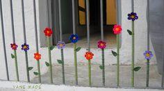 Yarn bombing: flowers on a railing
