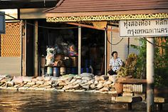 Widespread Flooding in Thailand Claims Lives, Displaces Hundreds of Thousands. A Bangkok shopkeeper waits for business behind a sandbag barrier against the flooding.#nonprofits #sponsor #child #children #poverty #infants #youth #hunger  #aid #Asia www.childfund.org