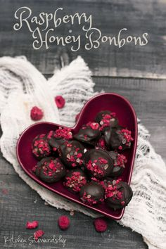 Raspberry Honey Bonbons Recipe - Bitter chocolate, crunchy salt, tart dried raspberries, and a surprising filling of honey. It is hard to go wrong with these bonbons ever, and they are especially suited for Valentine's with their naturally red garnish.