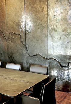 Metallic wall by Based Upon a London studio of artists designing & hand-making large reliefs.