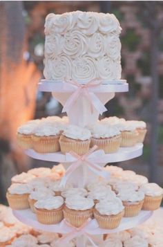 I love this rose cupcake tower (but not a fan of the pink) would do fewer cupcakes for our very intimate (okay yes...small amount of people) celebration.