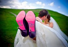 Photo of I Do written on bottom of bride's shoes