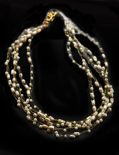 Jewelry designer Lois Becker wove Multi strand necklace of assorted pearls hand crocheted on fine gold wire to make this exceptional necklace a piece of art