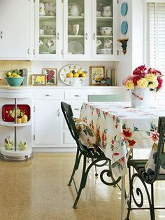 White kitchen shows off collections.  Colored accessories can be changed for a completely different look in the same room.