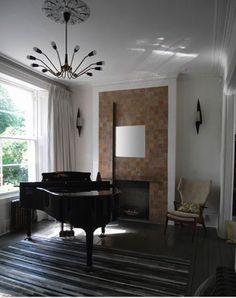 I can't resist any interiors space with a mini grand piano in it.