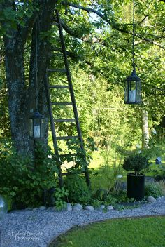 decorative garden touches: ladder, lanterns, stones...from The Swenglish Home