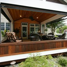 This deck/porch is part of a complete renovated backyard. The porch has a motorized screen an all three sides to maximize the view. The grill area is covered with an angled fiberglass pergola.